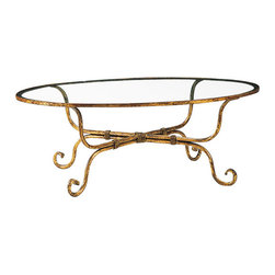 "Inviting Home - Oval Wrought Iron Coffee Table - Oval hand-wrought iron coffee table with distressed antiqued gold-leaf finish and glass top 49""W x 30""D x 17-1/2""H hand made in Italy Oval hand-wrought iron coffee table. Wrought iron coffee table finished in distressed antiqued gold-leaf and has 3/8"" thick glass top. This hand-wrought iron table is hand-crafted in Italy."