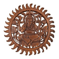 BaliBoutiqueOnLine - Ganesh Wall Art Relief Carving Decor - Ganesha sits on a lotus throne – a symbol of divinity. Carved by hand from suar wood, the Beloved Lord of Wisdom holds an axe and a lash to defend mankind from evil.   Hand carved wood wall art.