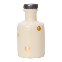 Apothecary Bottle - Polka Dot - One of a kind, handmade apothecary bottle with gold polka dots. The top half of the bottle has been finished with a clear glaze, allowing the beauty of the white porcelain to shine and the bottom half has been left unglazed and sanded to be smooth to the touch. The ceramic stopper has been glazed with a matte/metallic black. An eye-catching addition to a shelf, mantle or coffee table.