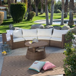 Coral Coast Albena All-Weather Wicker Curved Sofa Sectional Conversation Set - Arranged in a semi-circle or broken up and placed all around the table the modular pieces in the Coral Coast Albena All-Weather Wicker Curved Sofa Sectional Conversation Set offer flexibility for the best way to entertain. Consisting of a right arm chair a left arm chair and two armless chairs you'll find so many ways to use these pieces to create custom seating for any gathering. Supported by aluminum frames each piece is covered in woven resin wicker. The multi-tonal resin creates a more natural look that will look beautiful on your patio. Removable cushions in outdoor-ready Olefin fabric feature a honey welt and the round coffee table is shade-ready with an umbrella hole. Olefin which is solution dyed synthetic fibers best known for it's strength durability and comfort. Whether used indoors or outdoors near a sunny window or by the pool the soft comfortable cushions are resistant to bacteria mold mildew and odor. Most importantly they are also water- and fade-resistant. Brush off any dirt and clean with a solution of lukewarm water and mild soap. Sponge thoroughly with water. For stubborn stains or mildew mix three gallons of warm water with one cup of household bleach and one cup of mild detergent. Rinse thoroughly. About Coral CoastWhat if when you closed your eyes you pictured yourself in your own backyard? Coral Coast has a collection of easygoing affordable outdoor accessories for your patio pool or backyard. The latest colors and styles mingle with true classics in weather-worthy fabrics and finished woods ready for relaxation. Make yours a life of leisure.