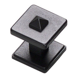Grand Rapids Accents Square Knob with Backplate - Matte Black - This square knob includes a diamond tip and square, ridged backplate, with a small stem running between the two. This shape helps to set it apart from the majority of knobs, and the diamond tip provides just a bit of detail to a charmingly simple design. A great choice for Mission or Craftsman styled homes.