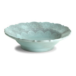 Marletto Aqua Serving Bowl - Redefine tradition on your table with this stunning ceramic vessel, the Merletto Aqua Serving Bowl. Its edges are detailed with a large-scale lace pattern, presenting feminine floral motifs and European splendor to your gaze, while the weight of its walls is a clue to its provenance: handmade in Italy from a fine black clay by traditional artisans of ceramics.