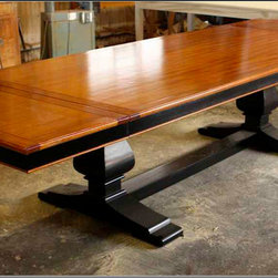 "Mortise & Tenon Custom Furniture Store in Los Angeles - Custom Mahogany Trestle Dining Table built by Mortise & Tenon in Los Angeles - If only clients knew how much time and details go into some of the custom furniture we build. This Mahogany trestle dining table gave our manager a workout since this table had to be built in solid Mahogany, lots of time was taken just to glue up all the parts before a single cut could be made. Most wood doesn't come in very thick dimensions so if we want 12"" thick trestle legs than we have to create this the old fashion way, one board at a time."