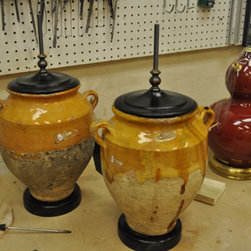 Lamp Making - These wine vessels had holes drilled in their bottoms for wiring, bases, and caps added.  They still need wires, harps for holding light bulbs, and shades.