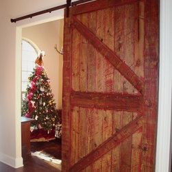 Lochside Residence - Custom designed, custom finished, and hand distressed sliding barn door featured in a Texas home.