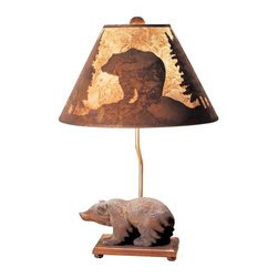 Mario Industries - Lodge Walking Bear Table Lamp - Light comes with a CFL bulb. Electric powered. Warranty: One year. Resin base. Brown color. 20 in. L x 10 in. W x 26 in. H (16 lbs.)Carved wood look bear sits on wood base-features silhouette shade which shows a bear scene when lamp is lit.