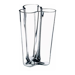 "Iittala - Aalto Vase 10"" Clear - Long-stemmed roses or lilies would be perfect for this extra-tall vase. Your bouquet will practically arrange itself into each delicate curve of glass. Just be sure to wash this special piece by hand and you'll enjoy it for many years to come."
