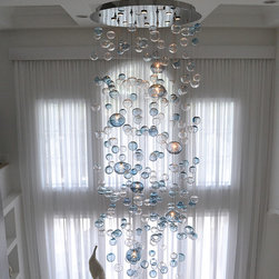 Bubbles Blown Glass Chandelier - This beautiful chandelier features blown glass bubbles cascading from an illuminated canopy. Each chandelier is custom made to order and can be made in virtually any shape and size.