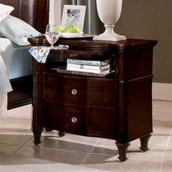 Sutton Place 2 Drawer Nightstand - Antique brass metal accents and a mid-20th century European design flair are elements that make the Sutton Place 2 Drawer Nightstand a stately addition to any room. A felt-lined top drawer safeguards delicate keepsakes while wood-on-wood guides provide smooth operation. Made with quality mahogany solids and cherry veneers and featuring exquisite dovetail construction, this nightstand will provide aesthetic and functional delight for years to come. Finished in a deep Espresso.About Wynwood FurnitureAt Wynwood, designing unique and useful furniture is the goal. The company's own fashion consultants scour the globe for distinctive woods and eye-catching designs before bringing their findings back home to talented designers who set about creating beautiful pieces. The designs are then moved into production, where Wynwood specializes in ensuring all collections are both stunning and useful, giving every piece a thorough going-over that results in inimitable style, impeccable construction, and unequaled functionality.