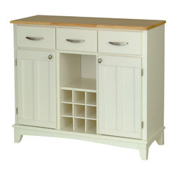 HomeStyles - Buffet in White Finish - Bring the perennial look of summer into your dining area with this white buffet. Natural finish top adds a handcrafted appearance along with accenting hardware in polished metal. Ample storage and utility drawers surround the central display space with wine cubbies. * Natural counter top. Two doors. Three utility drawers on metal drawer slides. Adjustable shelf for plenty of inside storage. Center wine storage area. Can be removed for open storage. Brushed steel hardware. Clear coat finish to help protect against wear and tear from normal use. Equipped with adjustable floor levelers. Made from Asian hardwood and wood products. Made in Thailand. Assembly required. 41.75 in. W x 17 in. D x 36.25 in. HThis buffet is designed to provide added storage and workspace for the kitchen and dining areas of the home.