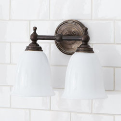 Quinn Beaded Double Sconce - The beading on the backplate and the aged look of this double sconce would add rustic charm to a powder room.