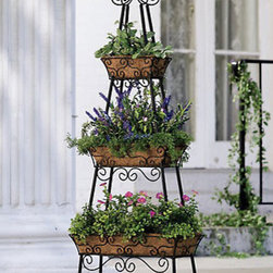 Pyramid Patio Planter - I'm always looking for ways to add height to my container gardening. It's even more important when you live in the city with limited space and privacy. This planter holds 3 levels of potted plants, letting you add variety and create a focal point on your patio, balcony or deck.