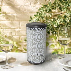 Smart Solar Frosted Fretwork Cylinder Solar Lantern - Add sophistication to your outdoor setting with the Smart Solar Frosted Fretwork Cylinder Solar Lantern. Featuring an elegant cylindrical shape with an ornate exterior, this solar-powered LED lantern will brighten your patio table, deck, or porch steps. It's constructed from galvanized steel and features a frosted glass design. It uses one energy-efficient LED light and casts a lovely fretwork pattern when lit.About Smart SolarDriven by a strong belief in the environmental benefits of solar power, and the realization that consumers are becoming increasingly environmentally aware with an interest in buying solar-powered products, Smart Solar was created in 2003. Based near Oxford in the U.K., Smart Solar has offices in the U.S. and Germany, and a manufacturing facility in Thailand. Smart Solar offers products including solar pumps, water features, lights, ventilators, chargers, and specialty garden items. With such a wide range of solar-powered products, Smart Solar uses an equally wide range of materials to make them, including terra cotta, ceramic, copper, slate, glass, aluminum, resin, and stainless steel. With an eye for fulfilling future consumer needs, and a heart for preserving the environment, Smart Solar is devoted to developing innovative, high-quality, and dependable solar-powered products.