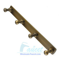 4-Peg Antique Brass Bathroom Robe Hook Rail - 4-Peg Hook Rail in Antique Brass adds a timeless and traditional appearance to your bathroom decor. The 4-Peg design helps provide ample storage of your bath robes and towels.