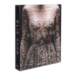 Elie Saab - Elie Saab, presented to you by Assouline in an oversized format with a luxury slipcase, is the perfect gift for those that appreciate the finer things in life.  Elie Saab tells the Cinderella story of a self-taught fashion designer who began by making clothes for his sisters while still only a young boy.  By his teenage years, he was selling clothes to the women in his neighborhood.  By 1982, he opened his first couture storefront in Beirut.  Famous for highlighting the female silhouette with only the finest materials and detailed embroidery, royalty and celebrities alike go to Saab to get their glam fix.  Original photography by the infamous Laziz Hamani comes alive on the glossy pages of Elie Saab.