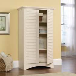 Harbor View Storage Cabinet - Hidden storage behind louver detailed doors. Four adjustable shelves. Full upper shelf. Detailing includes solid wood knobs. Antiqued White finish.