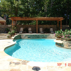 Pools - This swimming Pool and Spa are constructed of Gunite, lined with Pebbletec, and have a Salt System. The patio/Deck is Flag Stone with the walls constructed of Stacked Tennessee Field Stone. The Pergola is constructed of Cedar.