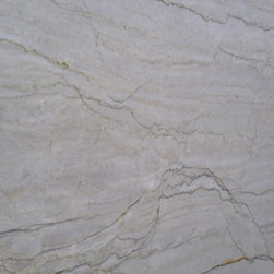 White Macauba Quartzite Granite - This is a great quartzite granite slab that has a similar color and pattern to Carrara White Marble.  A great option for people looking for the durability of granite with the movement and light color of marble.