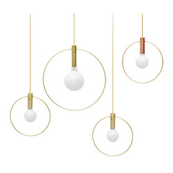 "Ladies & Gentlemen - Aura Pendant Lights - Ladies & Gentlemen - Ladies & Gentlemen's pared down the light into it's two elemental ingredients:  the source (the bulb) and it's illumination (highlighted by a brass ring).  The resulting Aura pendant lights are simple and versatile.  The two available sizes (10"" diameter or 15"" diameter) can be hung individually at adjustable heights or in clusters and rows.  Available with brass ring with a brass or copper base.  Comes pre-wired for ceiling mounting and includes canopy."