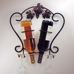 J & J Wire - J & J Wire 2-Bottle Wine & Glass Holder Multicolor - 4039 - Shop for Wine Bottle Holders and Racks from Hayneedle.com! Pouring a glass of wine will be just as fast as popping open a can of beer when you have your supplies at the ready in the J & J Wire 2-Bottle Wine & Glass Holder. This elegant wall-mounted rack makes it easy for you to enjoy a sophisticated beverage in style. Showcase two bottles of wine beneath the antique gold grapes and leaves and keep two wine glasses poised and ready for whenever the mood strikes. Proudly made in the USA from wrought iron with a black powder-coat finish this clever wine rack has sleek scrolled details that frame your upscale display.About J & J Wire Inc.Located at the Industrial Park in Beatrice Nebraska J & J Wire Inc. started 25 years ago as a wire-forming business manufacturing mostly houseware items. Since then the company has grown into a metal fabrication business serving customers in many different manufacturing sectors in the United States and Canada. From quilt racks to wine racks J & J Wire is committed to creating handmade works of art at affordable prices.