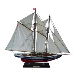 "Handcrafted Model Ships - Bluenose Limited 24"" - Wooden Sailboat Centerpiece - Not a model ship kit. Attach sails and Bluenose model yachts are Ready for Immediate Display. With a sleek elegance that won her numerous titles in both racing and fishing competitions, this brilliant model livens up any room or office. Amazing craftsmanship and attention to detail bring this fully assembled model yacht to life, adding a majestic piece of both Canadian and sailing history to your life. 24"" L x 4"" W x 20"" H."