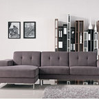 Adele Grey Fabric Sectional Sofa - Sectional with the inviting chaise-sofa combination is available in Left or Right Facing Chaise options. The sectional has a solid wood frame, box cushions, a grey fabric upholstery with tuftings, and metal legs.