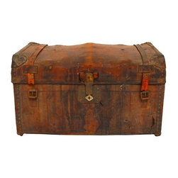 """Pre-owned Antique Leather Steamer Trunk - Antique leather and wood steamer trunk from 1884. Wear and losses to original leather that add to this piece's fabulous vintage patina. Remnants of straps on top and lots of old stickers. Intact leather handles and metal corner protectors. Rolls on casters.    Dimensions: 30""""w x 18""""d x 18""""h"""