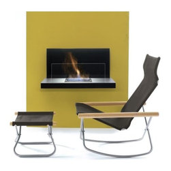 Design Within Reach - Wall Flame Fireplace - Don't let structural limitations get in the way of time spent gathered around the fireplace. The wall-mounted Wall Flame (2008) evokes the mood of a fireplace without knocking out a wall. Not requiring a flue, the uniform flame is created from clean-burning ethanol. Holding 2.5 liters of fuel, this unique fireplace create a cozy ambiance without creating much heat _ making it useful all year, indoors or out. Compact enough to be wall-mounted even in small spaces, it has a black backdrop to make the flame stand out. Its ceramic combustion chamber is double-walled for safety and has regulating flaps to adjust the flame size. Installation outdoors should be under a covered patio or porch, as water could collect in the fuel chamber. A metal bracket system makes wall installation simple.†