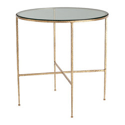 Winchester Hammered Iron/Glass side Table - Though the design of the Winchester Side Table is utterly simple, only a round glass top resting on four slender connected legs for an unadorned timelessness of form, the richness of this furniture piece is unmistakable. The metal frame is heavily textured with the marks and divots of hammering, then finished in a magnificently luxe and saturated gold leaf. This accent table strikes the perfect note in a minimalist transitional room and allows a satisfying openness in a more heavily-ornamented traditional design.