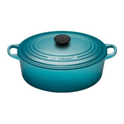 Le Creuset Caribbean Signature Oval French Oven - 6.75 qt. - Braising, roasting, baking, and searing to perfection, the Le Creuset Caribbean Signature Oval French Oven - 6.75 qt. offers you all of that and a stunning Caribbean blue exterior you'll love. This versatile oval-shaped French oven offers more surface area for cooking and features the stunning Caribbean blue enamel exterior plus sand-colored interior enamel coating that are both chip- and crack-resistant and virtually nonstick. This is an heirloom-quality cast iron piece that includes a lifetime warranty and will be treasured for generations. Features include ergonomic handles, unparalleled heat conduction, and convenient dishwasher-safe properties. Hard-working and beautiful, this oval French oven is crafted of premium enamel-coated cast iron, comes with a tight-fitting lid, and is the perfect 6.75-quart size, too. Time to cook up a storm!About Le Creuset of America Inc.From its cast iron cookware to its teakettles and mugs, Le Creuset is a global standard of inimitable color and quality. Founded in 1925 in the northern French town of Fresnoy-Le-Grand, Le Creuset still produces enameled cast iron in its original foundry. Its signature color, Flame, was modeled after the intense orange hue of molten cast iron within a cauldron (or Creuset in French), and has been a Le Creuset bestseller from the company's first year to the present day.Though best known for its vibrantly colored cookware and original inventions such as the Dutch oven, Le Creuset has also forged a name as a creator of stoneware mugs and enamel-coated stainless steel teakettles. The style and performance of Le Creuset's Cafe Collection and tea accessories are rooted in classic French cookware: bold colors, cylindrical loop handles, unmatched thermal resistance and heat distribution, and of course the iconic Le Creuset three-ring accent. Through its consistent qualities of authenticity, originality, and innovation, Le Creuset maintains a connection to both heritage and modernity.