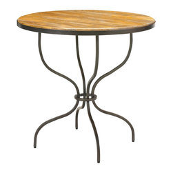 French Heritage - Cassel Table - This airy and eclectic little accent table is the perfect place to rest your wine glass. Much like a wineglass, it has a striking profile but a light presence, with four fine metal legs curving to form an open hourglass stem. The wood top is gently worn for a touch of vintage character.