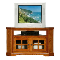 Eagle Furniture Manufacturers - Oak Ridge Corner TV Stand w Glass Doors (Medium Oak) - Finish: Medium Oak. Two glass panel doors. Designed with decorative molding and fluted detailing. Warranty: Eagle's products are guaranteed against material defects for one year from date of delivery to the dealer. Made in USA. No assembly required. 46.25 in. W x 25 in. D x 27 in. H (69.7 lbs.)The Oak Ridge collection combines American oak hardwood with updated contemporary styling. Heavy crown molding, sleek lines, fluted side molding, black brushed metal hardware, solid oak frames and solid oak recessed doors give this transitional collection a style all its own