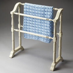 Butler - Butler Cottage White Quilt Rack/Blanket Stand - 5020222 - Shop for Caddies and Stands from Hayneedle.com! The Butler Cottage White Quilt Rack/Blanket Stand with its beautifully carved rods and molded base has a cozy country feel. Crafted from select solid woods this blanket rack is incredibly durable and the all-white finish really brightens any room. This is a great piece for hanging guest towels or showing off your favorite quilts duvets and comforters.About Butler SpecialtyButler Specialty Company has been designing and manufacturing high-quality occasional and accent furniture since 1930. Each piece reflects Butler's dedication to enduring design exquisite craftsmanship and top-quality materials. This family-owned company is based in Chicago. They scour the globe in search of the finest materials and most efficient means of production reflecting their commitment to providing excellent quality at exceptional value.