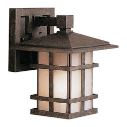 Kichler 1-Light Outdoor Fixture - Aged Bronze Exterior - One Light Outdoor Fixture. With rustic charm as unique as its design, the cross creek collection puts a modern spin on a classic fixture. Each piece is constructed from long lasting cast aluminum ensuring a quality fit and finish that will last for ages. Our aged bronze finish adds a distressed appearance to the piece, while textured linen seedy glass panels additional warmth make the cross creek collection the perfect balance of ambiance, style, and value. This one light wall lantern from the cross creek collection uses a 100-watt bulb and is 8 high. It is UL listed for wet location.
