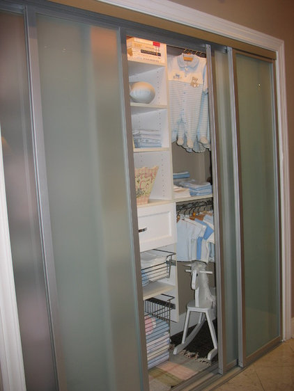 Contemporary Closet by Carson Closets & Cabinetry