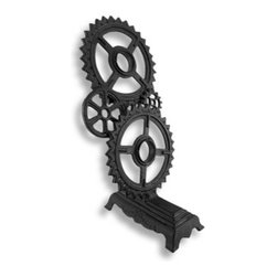 Industrial Steampunk Cast Iron Double Gear Wine Bottle Holder - This gear themed bottle holder is a great way to display 2 bottles of your favorite vino, while adding an industrial accent to your home decor. Made of cast iron, it measures 13 3/4 inches tall, 6 3/4 inches long, and 7 1/4 inches wide. It has an antique finish and looks great on tables or countertops. This piece makes a great housewarming gift that is sure to be admired.