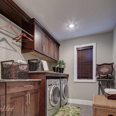 Transitional Laundry Room by Pacesetter Homes Edmonton