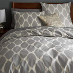 Ikat Ogee Duvet Cover - Gray goes with everything. The ikat pattern is very trendy right now, but this design is simple enough that you could add some other patterns, and it would still look great.