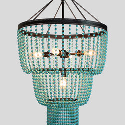 Saudade - Turquoise chandelier from Studio Jota. Five candelabra bulbs with customizations available in size, metal finish and bead color.