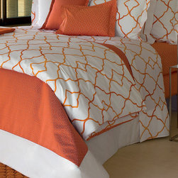 """Frontgate - Yves Delorme Jali Safran Coverlet - Made of Egyptian combed cotton. White background complements the crisp coral Safran graphic. Shams and flat sheets feature gate-like graphic on both sides. The duvet reverses to coral, with a small geometric pattern. Machine wash at a maximum of 140° Fahrenheit, regular spin cycle; do not use bleach. With a modern design echoing the lattice-like stone dividers (""""jali"""") used in Hindu and Arabic architecture, our Yves Delorme Jali Bedding Collection imbues your inner sanctum with a fresh yet private feel. The abstract, geometric coral graphic is printed on cool white percale.  .  .  .  . Machine wash at a maximum of 140 degrees Fahrenheit, regular spin cycle; do not use bleach . Do not tumble dry at a temperature exceeding 113 degrees . Do not iron at a temperature exceeding 302 degrees . Made in France."""