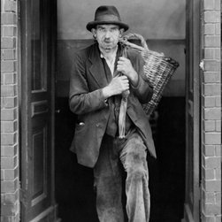 Berlin Coal Carrier, Berliner Kohlentrager 1932 Print - Photographed by August Sander in 1929.Photograph shows coal deliveryman, emerging from door of cellar, with empty coal basket, Berlin, Germany.