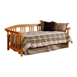 Hillsdale Furniture - Hillsdale Dorchester Daybed-Country Pine Multicolor - HL2279 - Shop for Daybeds from Hayneedle.com! The Hillsdale Dorchester Daybed - Country Pine takes inspiration from a variety of sources - Colonial tradition Pennsylvania Dutch workmanship Mission lines. But no matter where the influences come from there's no arguing that this piece is breathtaking and versatile. This daybed will work in any room - eclectic or traditional. Just dress it up in your favorite ensemble to give it your personal design touch. It's available in two finishes to complement any room. A trundle is an extra mattress frame stored beneath a daybed which slides out to provide additional sleeping space when needed. The optional trundle packages include your choice of a metal roll-out trundle frame or a metal pop-up trundle frame. The roll-out frame remains low to the ground as an additional twin-sized bed. The pop-up trundle can be left in the lowered position or elevated in the pop-up position to align with the primary daybed mattress. The pop-up feature allows the daybed to transform from a twin-size daybed into a king-size bed. Made of solid pine this daybed has an arm height of 30 inches. Clearance underneath the bed is 14-16 inches depending on the alignment holes used. The clearance is large enough to store the optional trundle underneath. The recommended weight for either the support system or optional trundle is 200-250 lbs. Some assembly required. About Hillsdale FurnitureLocated in Louisville KY Hillsdale Furniture is a leader in top quality affordable bedroom furniture. Since 1994 Hillsdale has combined the talents of nationally recognized designers and globally accredited factories to bring you furniture styling and design from around the globe. Hillsdale combines the best in finishes materials and designs to bring both beauty and value with every piece. The combination of top quality metal wood stone and leather has given Hillsdale the reputation for leading-edge styling and concepts.
