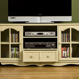 Upton Home - Medallion Antique White Entertainment Center - This antique white entertainment center combines modern functionality with an old-fashioned style. The wood media center can accommodate most flat screen televisions. Adjustable shelving and one drawer provide room for media accessories.