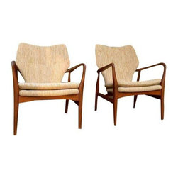 Used Mid-Century Modern Teak Lounge Chairs - A Pair - With a jaw dropping shapeliness, this pair of Mid-Century lounge chairs is high on our list of most coveted furniture. The teak frame boasts phenomenal wood grains and the oatmeal tweed upholstery is nothing short of delicious. We could go on forever about the various design details, like the sculptured arm rests and comfortable back support, but we think these chairs speak for themselves. If you have been searching for a truly amazing, unique pair of arm chairs in perfect condition, this is your set!