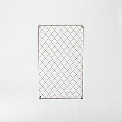 Lattice Weave Wall Trellis - A wall trellis is a great place to hang a party banner. This metal design would look great in any garden.
