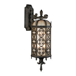 Fine Art Lamps - Costa del Sol Outdoor Wall Mount, 338481ST - This lantern's decorative wrought iron quatrefoil designs evoke the historic romance of the Mediterranean coast. The subtly iridescent, textured glass gives the light a soft, diffused glow.