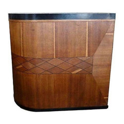 Used Vintage Inlaid Wood Bar - Belly right on up to this unique bar! Featuring a rounded front, it is inlaid with contrasting panels of wood that form an abstract design. The back has plenty of storage, including a shelf and a drawer. Portions of the bar are edged with chrome, and the top is yellow Formica. Now it's always happy hour in your home!