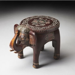 Butler Accent Table - Artifacts - 17W in. - You'll be ready to pack your trunk for a little ele-fun with the Butler Accent Table - Artifacts - 17W in. in your home. The solid mango wood design features textured hand-painted details give an elegant and fun accent. The cheeky elephant shape features a round top for display and is sure to provide an attractive and charming look to any room.About Butler SpecialtyButler Specialty Company has been designing and manufacturing high-quality occasional and accent furniture since 1930. Each piece reflects Butler's dedication to enduring design, exquisite craftsmanship, and top-quality materials. This family-owned company is based in Chicago. They scour the globe in search of the finest materials and most efficient means of production, reflecting their commitment to providing excellent quality at exceptional value.