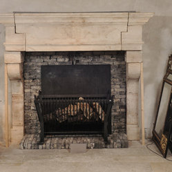 Antique Fireplaces out of Reclaimed Antique Stone (Mediterranean Style) - This is a simple hand carved picture frame Bolection stone fireplace mantle installed with antique herringbone terracotta brick size tiles, Brought to you by our carvers at Ancient Surfaces.