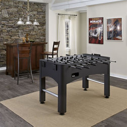 HomeStyles - The Modern Pro Foosball Game Table - Bring on the competition with the Home Styles Modern Pro Foosball Game Table. The Modern Pro Foosball Game Table is the perfect foosball table for a player of any skill set. The foosball table is constructed of engineered wood and plywood frames with a vinyl wrap in a black and silver finish. Features include chrome steel rods, plastic handles, robot-style black and silver players, internal side ball return, a sliding score abacus, and four built-in cup holders. Playing surface measures 46.75 in. W x 26.75 in. D. Adjustable leg levelers make installation and leveling easy on uneven floors. Whether you're a pro or an amateur, don't miss out on hours of family fun with the Home Styles Pro Foosball Table. Assembly required. 55 in. W x 29.75 in. D x 35 in. H. Includes two (2) balls.
